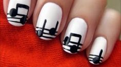 Easy Music Nails, via YouTube.  The link also has some other nail designs, that look super cute and easy! :)