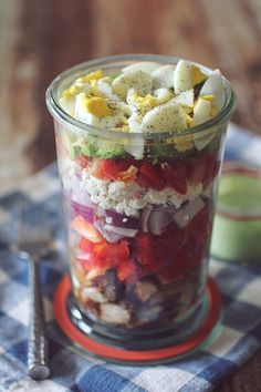 """Layered Cobb Chicken Salad- To Go: """"I love this cobb salad recipe for many reasons. The combination of flavors, the filling and satisfying ingredients, but most of all- I love the fact that it is portable and a quick and easy meal to prepare in advance! I like to prepare these cobb salads to-go a week in advance and enjoy them as a quick and easy lunch throughout the week!"""""""