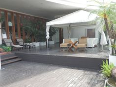 Outdoor massage area poolside at the Millennium Hilton Hotel in Bangkok, Thailand