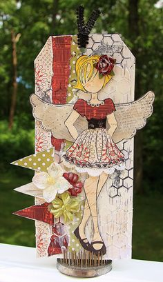 """Tag using Julie Nutting's new mixed media doll stamps. This is """"Riley"""", one of the smaller stamps in the new set. This will be for a Christmas in July project for my LSS!"""