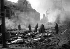 Survivors sort through the dead after the aerial bombing of Guernica during the Spanish Civil War. April 1937 [NSFW] [21261508]