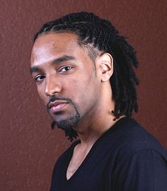 Braided loc style for men. Love his healthy locs!