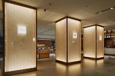 located in shenzhen's MIXC commercial complex, yan bookstore by tomoko ikegai / ikg inc is closed off by a long façade of rammed-earth walls. Rammed Earth Homes, Rammed Earth Wall, Column Lights, Commercial Complex, Commercial Design, Pillar Design, Living Room Decor Inspiration, Column Design, Earth Design