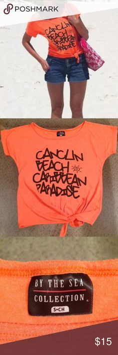 Set T-shirt Top size S Cancun Denim shorts size 25 Cute set top Bright orange Cancun and denim shorts size 25. Top excellent condition, shorts have small seam( see pictures) overall in excellent condition. Come from free smoke and free pets home.  Feel free to contact. by the sea Tops Crop Tops