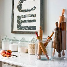 Kitchens are hard rooms to decorate, but glass canisters can add a decorative yet utilitarian touch to the space