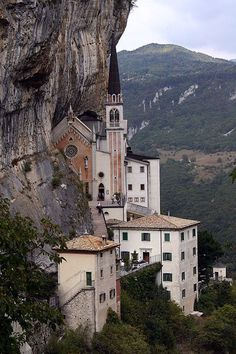 """Sanctuary Madonna della Corona, dedicated to the """"Lady of Sorrows"""" near Spiazzi, Veneto, Italy.  It is located at 700 meters up the vertical rock face, completely excavated into the rock. Its construction dates primarily from mid-16th to early 17th century."""