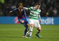 Ivan Rakitic of Barcelona vies with Erik Sviatchenko of Celtic during the UEFA Champions League match between Celtic FC and FC Barcelona at Celtic Park Stadium on November 23, 2016 in Glasgow, Scotland.