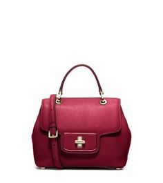 Exclusively Ours in the U.S. in Michael Kors stores and on michaelkors.com until 1/31/16. Featuring fine leather craftsmanship and a ladylike shape, our Emery satchel is the epitome of elegance. Classic details like a single top handle and protective metal feet nod to classic design, while the high-shine hardware and adjustable shoulder strap speak to the here and now.