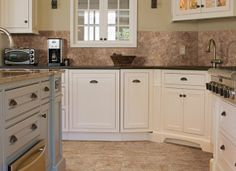 White #kitchen cabinets and beige #granite countertops.