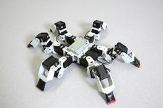 Six-Legged Robots Exhibit Faster Gait Than Observed in Nature