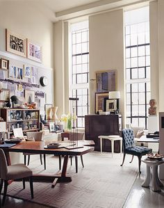 I like the eclectic mix of art.  creatively managed chaos.  maybe something like this for the office?