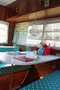 I like the beaded candle holder hanging under the cabinets 1967 Yellowstone vintage trailer interior