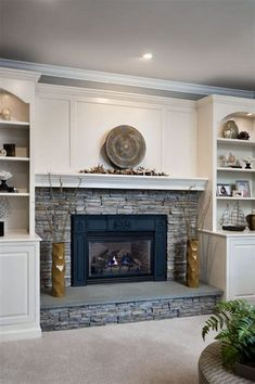 stacked stone fireplace built-ins Nice but maybe rock to ceiling? Built ins look pretty dated to me. Fireplace Bookshelves, Brick Fireplace Makeover, Fireplace Built Ins, Home Fireplace, Fireplace Remodel, Living Room With Fireplace, Fireplace Surrounds, Fireplace Design, Fireplace Ideas