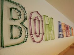 Yarn letters plus can go to another source w more fun wall decor ideas.