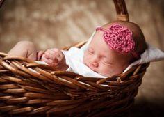Newborn girl in studio