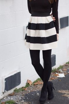 Newsprint Stripe Skirt: Look #3 -- you can make the skirt really stand out by pairing it with a black long sleeve top, black tights, and black heels. Doing so will elongate your legs too!