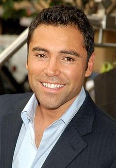 """Oscar De La Hoya is a retired Mexican American professional boxer. Nicknamed """"The Golden Boy,"""" De La Hoya won a gold medal at the Barcelona Olympic Games shortly after graduating from James A. Ufc, Famous Left Handed People, Famous Hispanics, Male Movie Stars, American Boxer, Hispanic Men, Mexican Men, Mexican American, The Golden Boy"""