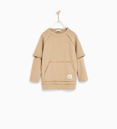 Zara Kids SS17 - DOUBLE SLEEVE EXTRA LONG SWEATSHIRT: Sweatshirt with round neck and double raglan sleeves featuring frayed seams. Pouch pocket with hem appliqué. Large size.
