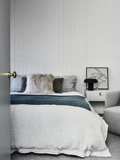 minimalist modern bedroom with blue and grey palette