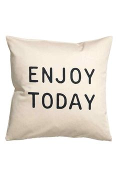 Text print cushion cover: Cushion cover in cotton twill with a text print on the…