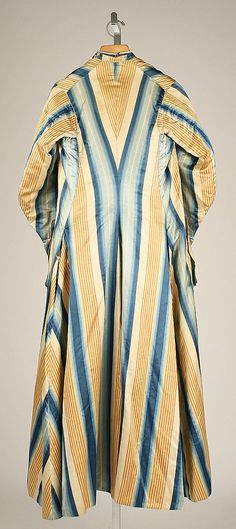 Back view, man's at-home ensemble of banyan, waistcoat and breeches, Europe, second half 18th century. Banyan and waistcoat made of cream, yellow and blue striped silk, lined with linen; breeches: blue wool.