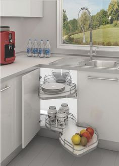 This handy kidney-shaped pull-out shelving unit fits a 1000mm kitchen base unit. The unit has a light in it, great idea.