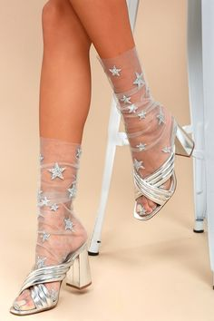 """Look absolutely whimsical in the Lirika Matoshi Stars in Her Eyes Silver Glitter Star Print Tulle Socks! Sheer tulle fabric, with adorable glitter stars, shapes these trendy socks. Measures 11"""" from heel to top of cuff (relaxed). One size fits most."""