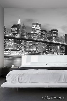 Brooklyn Bridge Wallpaper creates excitement to walls. It adds a modern flair to New York themed bedroom, living room, bathroom or dining rooms. The photo taken at night has a black and white filter over it, making it perfect for a grey room. The NYC wallpaper is easy to hang, removable and eco-friendly. Bridge Wallpaper, A N Wallpaper, Grey Room, Bedroom Themes, Brooklyn Bridge, White Walls, Dining Rooms, Wall Murals, New York Skyline
