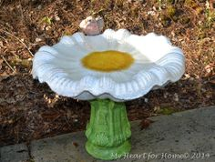Use patio paint to turn a simple grey cement bird bath into a beautiful flower bath that invites the birds!