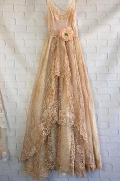 One of a kind Boho wedding dress. The top of the stress his hands or eyes dark cream nylon lace and adjustable straps. The skirt has several layers. The top layer is from a 1950s vintage wedding dress. Ive hand dyed it a dark tan. The front is three tiers of ruffles & on the backside is a straight layer of lace. Overlaid on a cream background. Lined up to the knee underneath. Light cream lace waistband with lace sash. Pale pink and cream silk flower has swavroski crystal center… It is o...