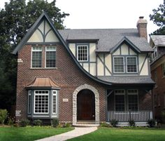 Love the slope of this roof, and the transition into the porch. Tudor Style!