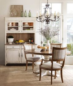Hooker Furniture - Chic Coterie Collection      This would be great for small scale area.  Look at the storage the cabinet provides.