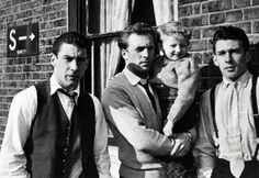 Ronnie, Charlie, Gary and Reggie Kray outside their home at Vallance Road in Bethnal Green
