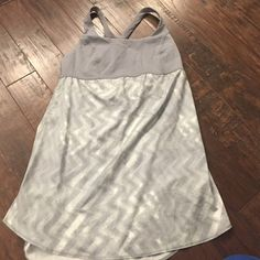Lululemon top Grey top with thin bottom that has small slits at hem. Not sure what the style is called. lululemon athletica Tops Tank Tops