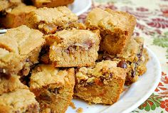 magic cookie bars - graham cracker crumb cookie base, chocolate chips, butterscotch chips, flaked coconut and walnuts