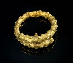 Golden bracelet made of two halves in shape of clubs. Roman, 1st century A.D.