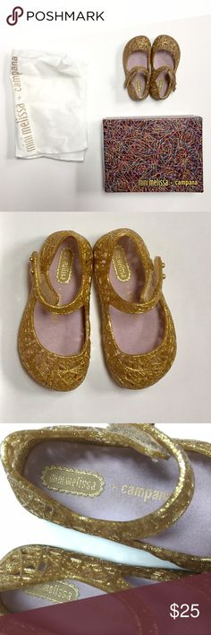 Mini Melissa Campana shoes Adorable gold jelly shoes, perfect for summertime. Good condition, used but lots of life left. These are great in the water and smell like bubble gum! Mini Melissa Shoes Sandals & Flip Flops