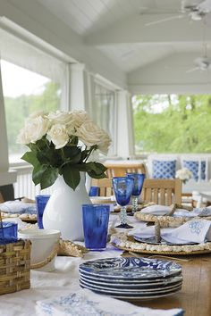 Coastal beach table dining tablescape...see a DIY with the shell rattan plate chargers
