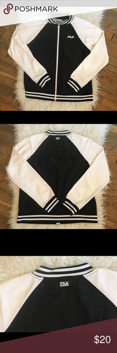 FILA Black + White Retro Style Jacket ZIP UP Sz M FILA Sport Women's  Black Polyester track jacket  Size M Soft thin polyester material Stretchy ringer collar and cuffs  Partially lined inside with mesh  Great condition!  Is a modern item but has a retro sporty style Fila Jackets & Coats