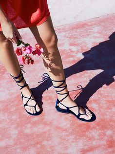 Aria Velvet Sandal   Strappy velvet sandal featuring a lace-up adjustable tie. Toe thong.
