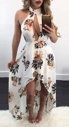 Choker halter neck sweetheart center cutout asymmetrical flare elegant floral print maxi dress  Details    Polyester  Broadcloth  Imported  Delicate Cold Wash  Fits True To Size