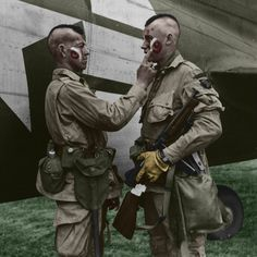 Private Ware applies last second war paint to Private Plaudo in England June 1944. Description from en.wikipedia.org. I searched for this on bing.com/images