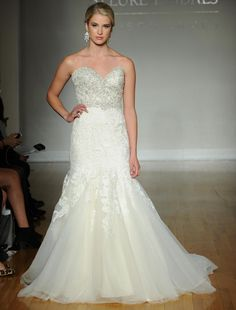 Allure fall 2016 wedding gown with sweetheart neckline, beaded bodice with an elegant lace into tulle skirt | https://www.theknot.com/content/allure-wedding-dresses-bridal-fashion-week-fall-2016