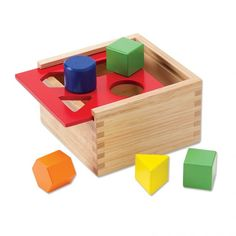 Shape Sorting Box: Although this sorting box is recommended for 2-4 year olds, it is perfect for young toddlers (18 months to 2 years). Although toddlers grasp the concept of object permanence, they still love pushing back the wooden lid to find the blocks inside. If you slowly show toddlers how to place the blocks into their respective cutout shapes, they will master it in no time. I recommend showing children how to use this material and then allowing them to explore with it on their own.