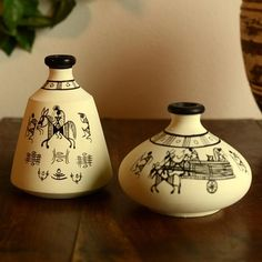 A very charming and ethinic black and white earthen miniatures set of 2 in terracotta in unique shapes with handpainting of working men on the pots with black paint. - cooliyo.com