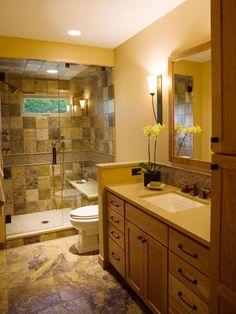 This bathroom features a performance shower with floor-to-ceiling marble tile and a frameless shower. The bathroom, also has a custom-designed vanity with a tiled backsplash that complements the shower. Simply beautiful!