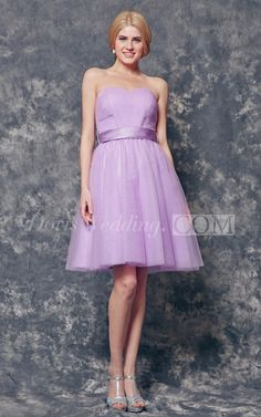 The A-line, short Tulle bridesmaid dress is equal portions sexy and classy for that summer wedding you don't want anyone to forget! With a tempting sweetheart neckline that stretches into an interestingly patterned bodice and a removable ribbon belt that ties into the cutest little bow in the back, this dress is all you need to look like the most important people at the wedding! #short #lavender #DorisWeding.com