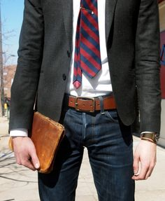 grey jacket, blue and red tie, denim, cognac belt and leather sleeve