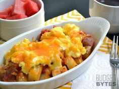 Country breakfast bowls combine seasoned and roasted potatoes, salsa, scrambled eggs, and cheddar cheese. Make them now and freeze for later!