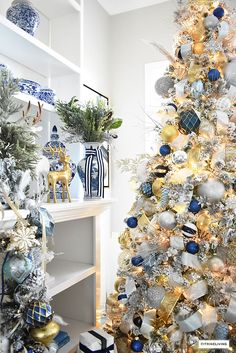 Christmas Home Tour - Gorgeous living room dressed in blues, gold, silver and flocked greenery is sophisticated,elegant and has an elevated look and feel. #christmas #christmashometour #livingroom #christmastree #christmaslivingroom #blueandwhite #blueandwhitechristmas